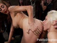 Katie Summers gets the ultimate Public Disgrace treatment. Tied and completely helpless she is at the mercy of the crowd. Everything from the air that she breathes to the orgasms that she has are out of her control. She is brutally fisted, dp'ed, made to suck cock, lick pussy, and eat cum out of Princess Donna's cunt. Lucky girl!!video