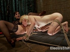 Episode 2: With skin as white as porcelain, blonde hair and blue eyes, Alani is the kind of girl I want in my restraints. She's also come to break in her ass and pussy to electrical penetration for the first time!Suspended in chains with arms behind her back and legs spread, I open the session by fucking her with an electrically-charged dildo, a Hitachi Magic Wand and sparking her nipples with a cattle prod, bringing out the first round of many mind-blowing orgasms. But she's come here for her first experience with electrical anal and double penetration in her tight puckered asshole and lily white pussy, and I oblige her. Restrained with ropes on all fours on a grate, She has no idea what she's in for. The shock on her face is her genuine first reaction to the electrifying sensation of having all her holes filled and zapped. Alani shrieks as I also apply the Magic Wand her to her clit.I can't let her go without giving me some, so I spread my legs open and she eats my cunt. What can I say? It's good to be the boss.video