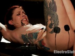 Episode 4: With multiple piercings and even more tattoos, Krysta Kaos looks the part of someone who likes BDSM. But I'm just interested in giving her a fucking with my electrical strap-on! Tying her up to a table, with her legs in the air giving me full access to her ass and pussy, I start out by wiring her ass and abs with sticky pads. I fuck her silly with an electrical strap-on while controlling her muscles with the pads, adding to her agony with nipple clamps that tops her all-natural tits. Krysta cums hard, and I make sure it's genuine as I rip the nipple clamps onto her while her clit's overly stimulated. I know she had fun, because shocking and taking Krysta with my strap-on was fun for me!video