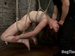 Hot bondage toughie Sarah Shevon gets put to the test here at HogTied. She gets challenging positions and pushed consistently to the edge by Danny Wylde. In the first scene, we give Sarah a classic tie from the HogTied arsenal - the hogtie beam suspension. What I love about this tie is the vulnerability of the feet and the ass and the fact that she is completely plastered against the beam unable to escape. Danny takes his time unwrapping his present and pushing her with the corporal, urging her to endure and rewarding her with anal only no vibrator orgasms. In the second position, Sarah is placed in a face up hogtie suspension. Whats so hot about this position is that her knees are tied open with a wood pole. Its impossible to close her legs and Danny takes full advantage of that opportunity. In the third position, Sarah is bound in an experimental open legged ball/basket inverted suspension, at perfect dick height. Danny stuffs her face full of cock and drops a fat load on Sarah's face. Cramming her ass full of dildo, relentless orgasms are squeezed from her willing body until she is completely exhausted.video