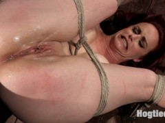 Bella is fucking back and looking hotter than ever. We begin with a standing spread eagle, her hair tied up, and the anxiety begins. She is flogged all over and then a crotch rope is added before she is allowed her final orgasms for this scene.Next she is put in a grueling back bend and she is tormented even more. This slut takes a good amount of punishment before we start to fuck her mouth and pussy. The more helpless she is the more her pussy craves the attention so we fill that whore hole up and rip orgasms out of her like there's no tomorrow.In the final scene we put our cum slut in a nasty pile driver on the floor. This time the cane comes out and we see Bella suffer like only she can. Her legs and feet are tormented and then we start fucking her pussy and mouth again.video