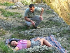 A girl is fast asleep, lying on a blanket on the hillside. A guy approaches who tries to wake her up. When she doesn't respond, het takes out her titties and plays with them. Finally he fucks the girl too.video