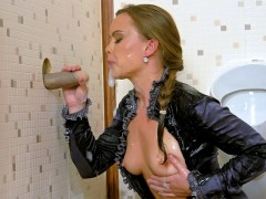 This gorgeous blonde hunnie gets wet and ready when she sees our fake cock poking out of the gloryhole. She strokes and sucks it and it rewards her with massive spurt after spurt of slime gushing from it. It turns her on so much she pulls out her titties and her pants down slightly to rub her aching needful pussy.video